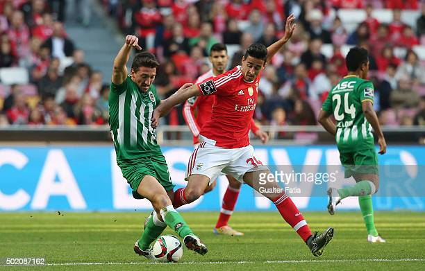Rio Ave FC's midfielder Pedro Moreira with SL Benfica's defender Andre Almeida in action during the Primeira Liga match between SL Benfica and Rio...