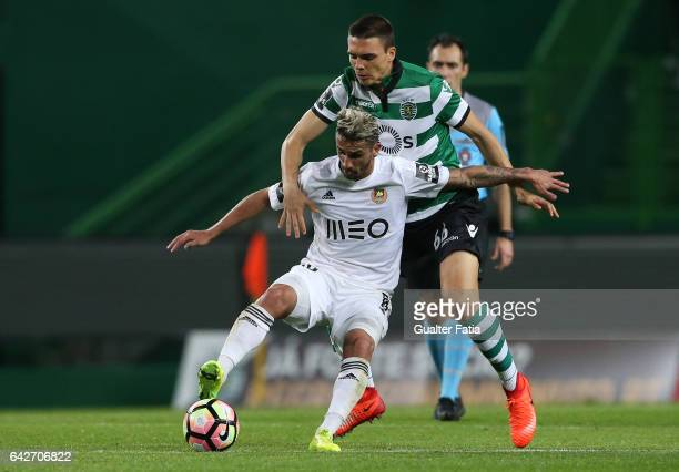 Rio Ave FC's midfielder Ruben Ribeiro with Sporting CP's midfielder Joao Palhinha from Portugal in action during the Primeira Liga match between...