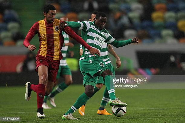 Rio Ave's forward Ahmed Hassan vies with Sporting's midfielder William Carvalho during the Primeira Liga match between Sporting CP and Rio Ave at...