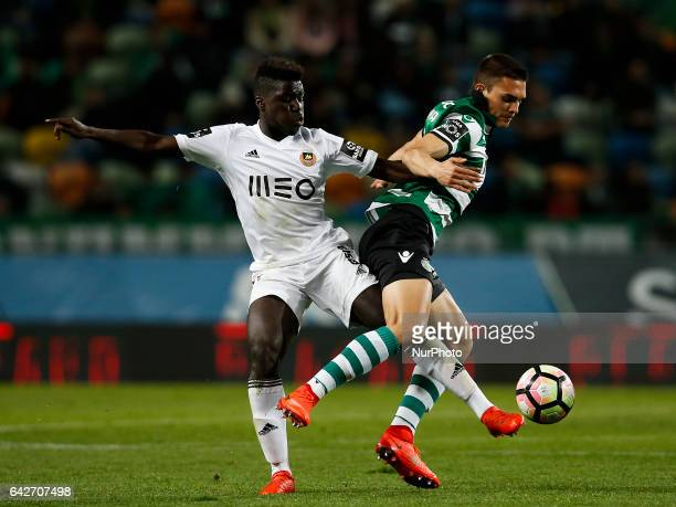 Rio Ave's midfielder Jaime Pinto vies for the ball with Sporting's midfielder Joao Palhinha during Premier League 2016/17 match between Sporting CP...