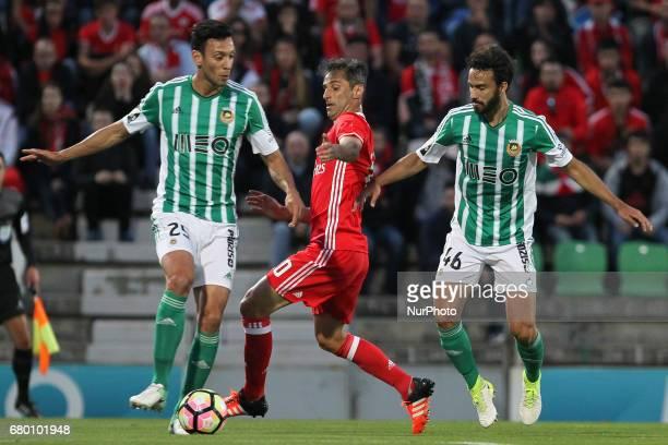 Rio Ave's Portuguese defender Roderick Miranda with Benfica's Brazilian forward Jonas and Rio Ave's Brazilian defender Marcelo during the Premier...
