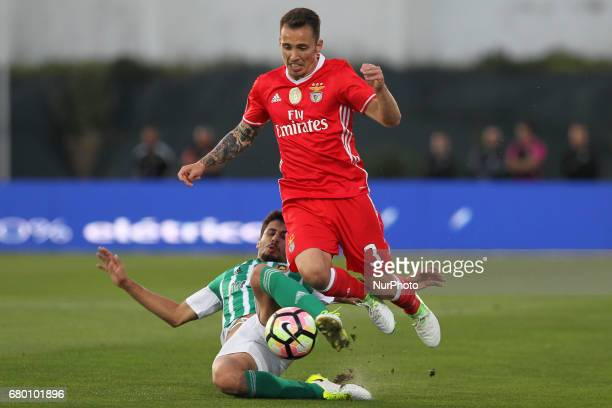 Rio Ave's Portuguese forward Gil Dias with Benfica's Spanish defender Alex Grimaldo during the Premier League 2016/17 match between Rio Ave and SL...