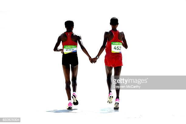 Rio Brazil 14 August 2016 Women's marathon winner Jemima Jelagat Sumgong of Kenya left and second place Eunice Jepkirui Kirwa of Bahrain following...