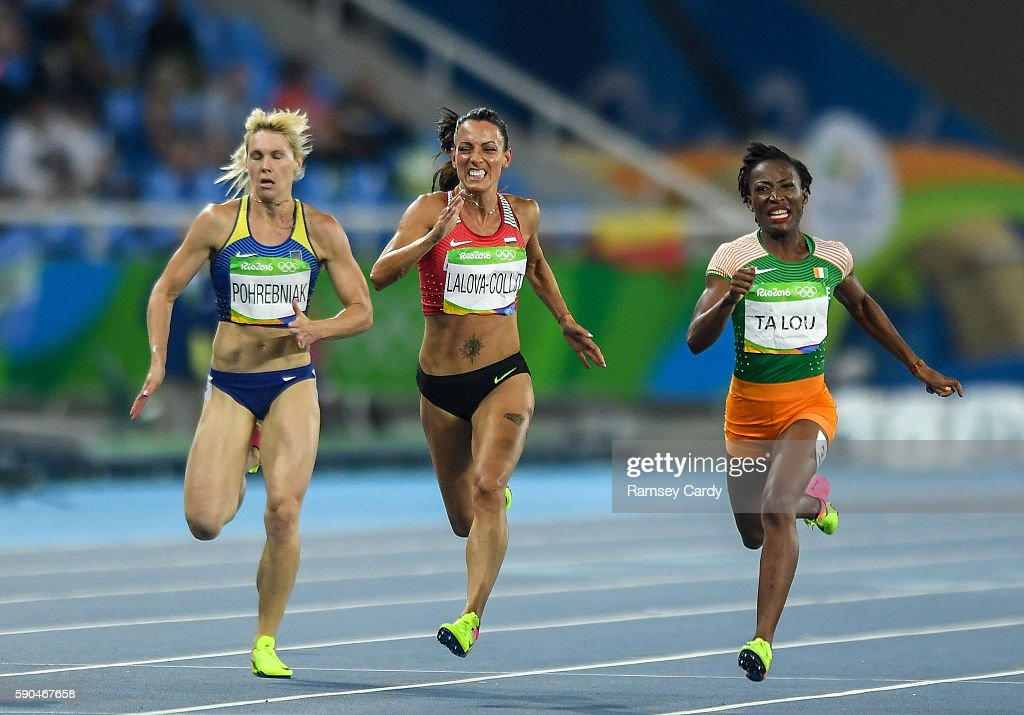 Rio Brazil 16 August 2016 MarieJosee Talou right of Ivory Coast and Ivet LalovaCollio of Bulgaria competing during the Women's 200m Semifinal at the...