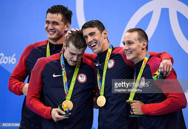 Rio Brazil 7 August 2016 Team USA from left Nathan Adrian Ryan Held Michael Phelps and Caeleb Dressel with their gold medals after they won the Men's...