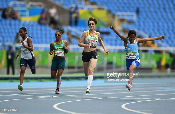 Rio Brazil 9 September 2016 Yanina Andrea Martinez of Argentina right wins the Women's 100m T36 Final from second place Claudia Nicoleitzik of...