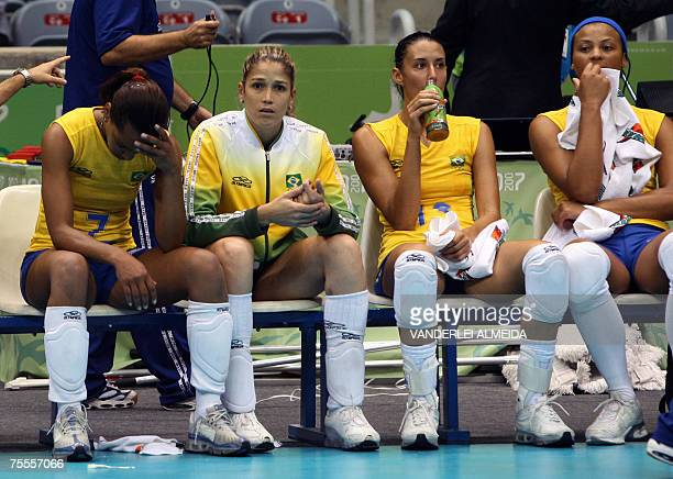 Brazilian players sit on the bench after their loss to Cuba in the final of volleyball competition in the Maracanazinho stadium 19 July 2007 in Rio...