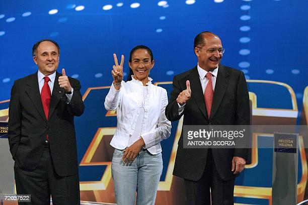 Brazilian presidential candidates Cristovam Buarque Heloisa Helena and Geraldo Alckmin pose prior to a televised final debate in Rio de Janeiro 28...