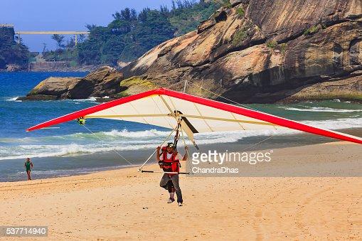 Rio de Janeiro, Brazil: Hang Glider landing on Sao Conrado