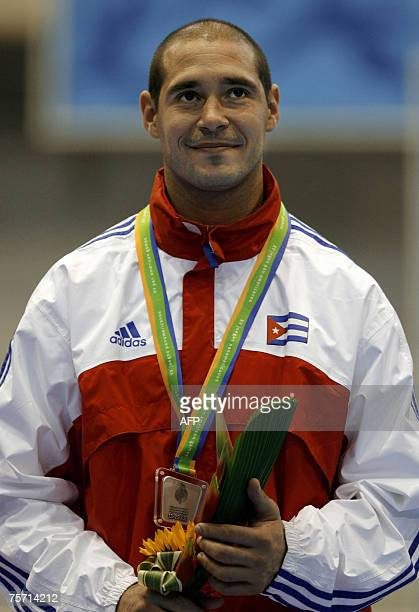 Silver Medal Jorge Zaragoza of Cuba smiles during the award ceremony after losing to Gustavo Dionisio of the Dominican Republic in the Karate Men 75...