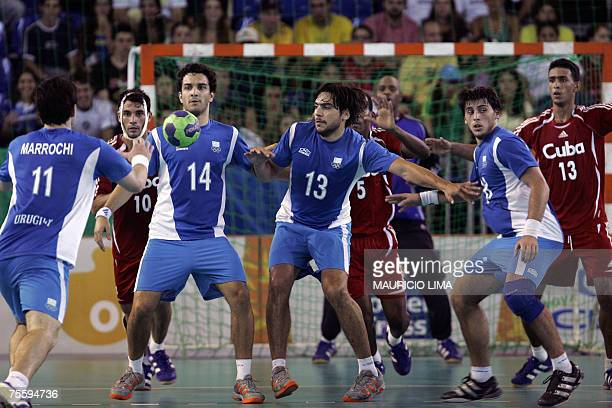 Uruguay's Pablo Marrochi receives the ball to lose the last throw of the team against Cuba in the final seconds of their Rio 2007 XV Pan American...