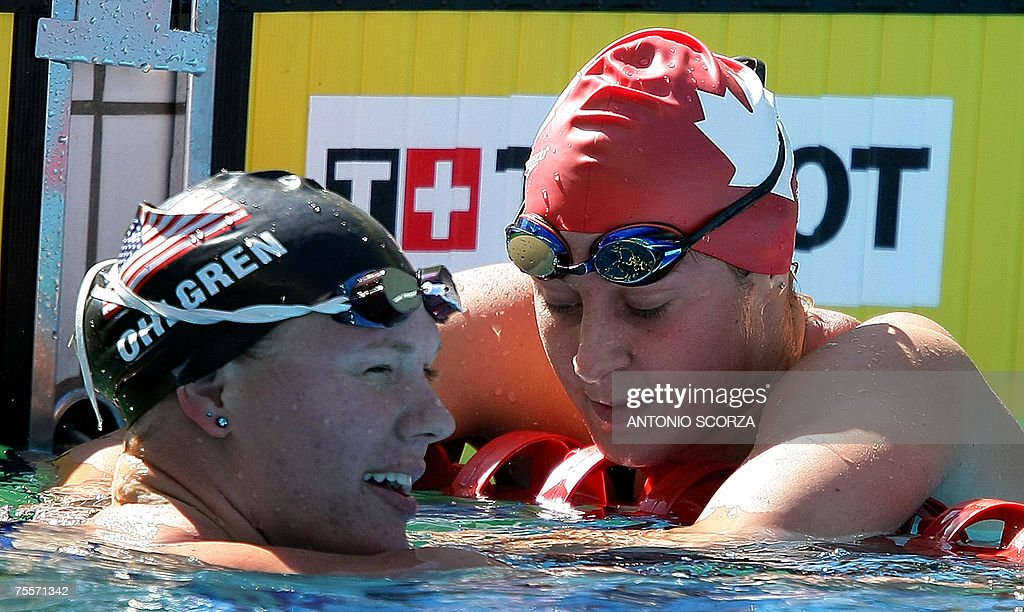 US swimmer Ava Ohlgren(L) talks with Canadian Stephanie Horner after winning the Gold Medal in the 200m Freestyle final, 20 July 2007, in the Pan American games in Rio de Janeiro, Brazil. Horner won the Silver Medal. AFP PHOTO ANTONIO