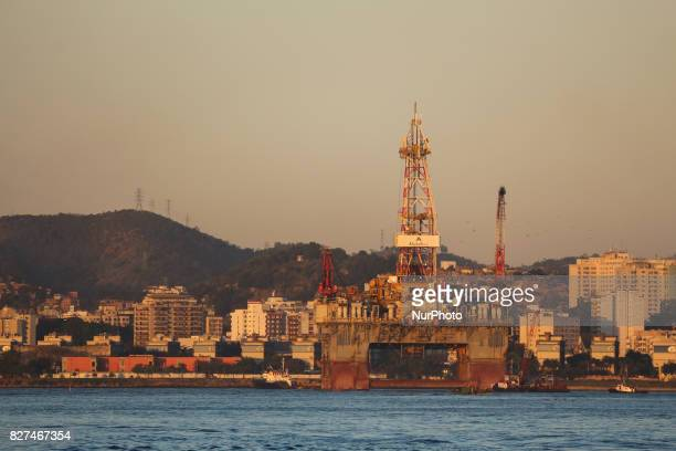 Rio de Janeiro has sunny and hot afternoon in winter In this image oil platform anchored in Niteroi during sunset seen from Guanabara Bay Downtown Rio