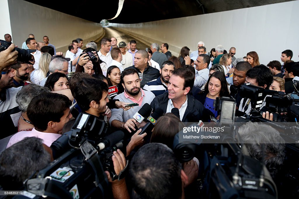 Rio de Janeiro Mayor <a gi-track='captionPersonalityLinkClicked' href=/galleries/search?phrase=Eduardo+Paes&family=editorial&specificpeople=5692531 ng-click='$event.stopPropagation()'>Eduardo Paes</a> fields questions from the media after delivering Tunnel Engineer Paulo Cezar Marcelino Figueire, Tunnel Engineer Luiz Jacques de Moraes and Presidient Itamar Franco High Road as part of new infrastructure to connect the south zone with Barra da Tijuca on May 28, 2016 in Rio de Janeiro, Brazil.
