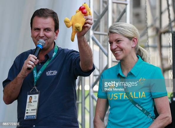 Rio de Janeiro Mayor Eduardo Paes gets a toy kangaroo from the Australian delegation head Kitty Chiller during a ceremony at the Olympic Village on...