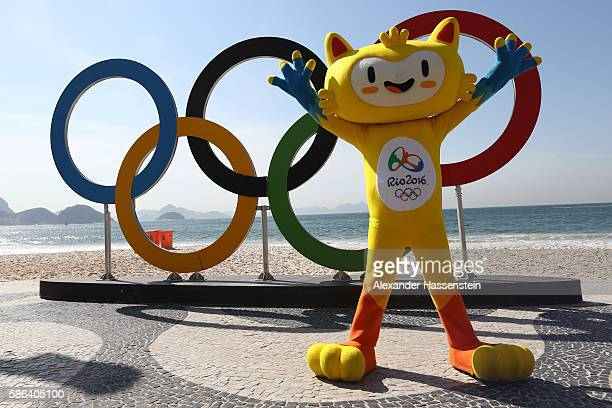 Rio de Janeiro Olympic mascot Vinicius poses in front of the Olympic Rings before the Men's Road Race on Day 1 of the Rio 2016 Olympic Games at the...
