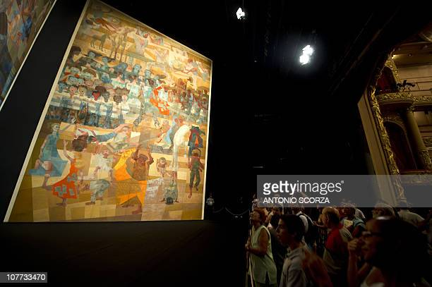 Rio de Janeiro residents and tourists attend a public presentation of Brazilian painter Candido Portinari's 'War and Peace' painting at the Municipal...