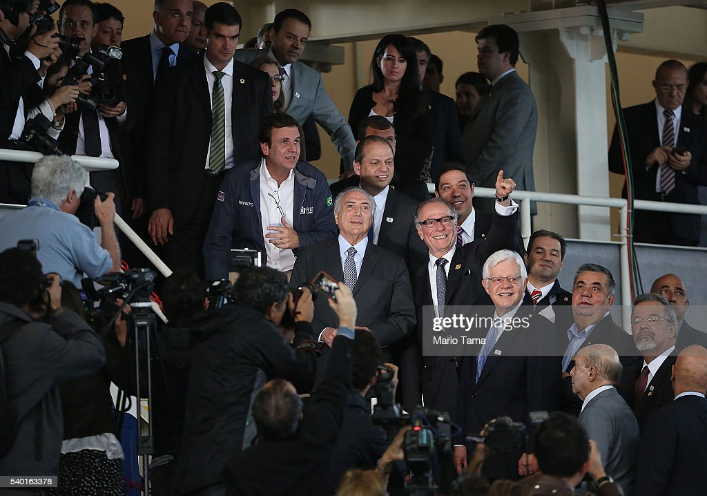 Rio de Janeiro's Mayor Eduardo Paes stands with Brazil's interim President Michel Temer and president of the Brazilian Olympic Committee Carlos...