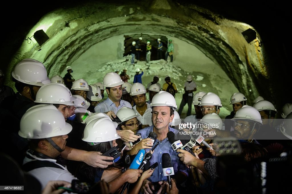 Rio de Janeiro's Mayor Eduardo Paes talks to the media at the last excavation of the new 302km road tunnel in Rio de Janeiro Brazil on March 24 2015...