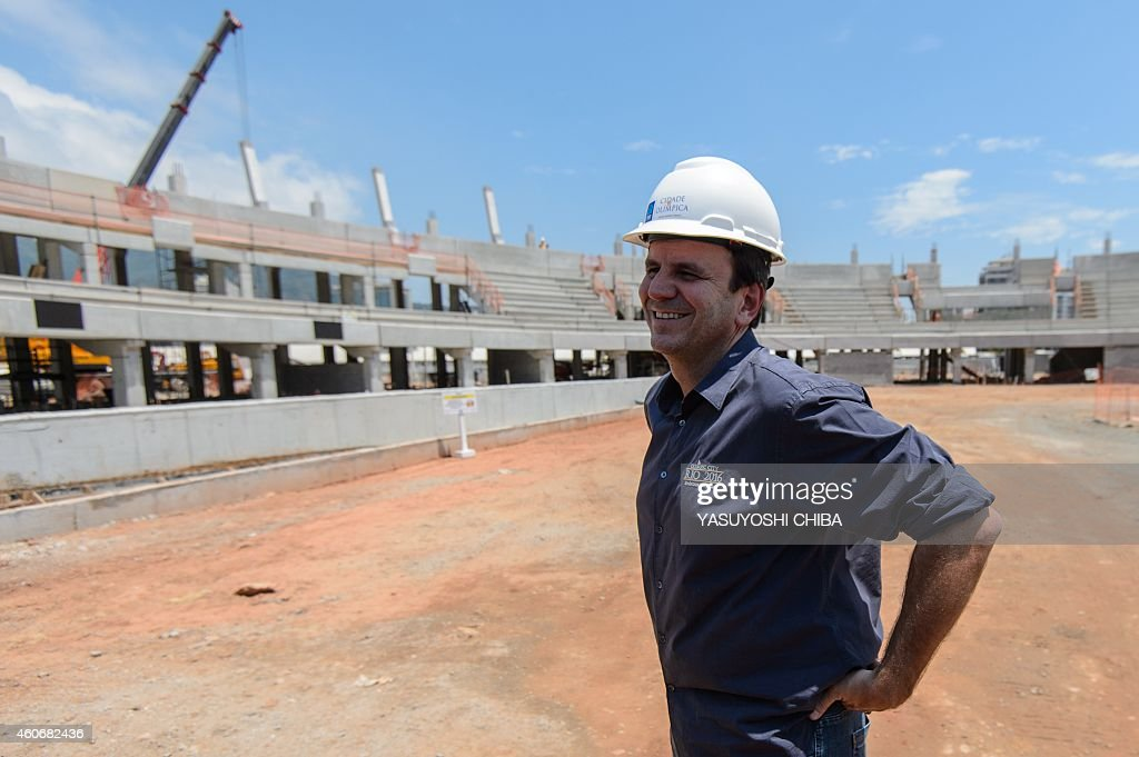 Rio de Janeiro's mayor Eduardo Paes visits the construction site of the Olympic Park for the Rio 2016 Olympic and Paralympic games after a press...