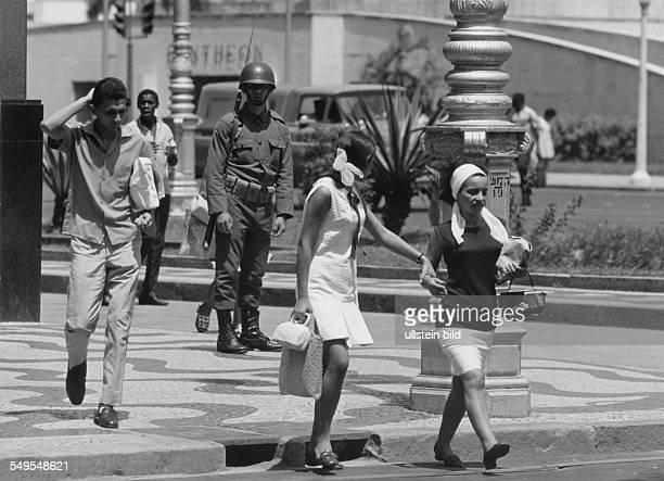 Rio de Janiero street scene pedestrians and soldier Vintage property of Ullstein Bild