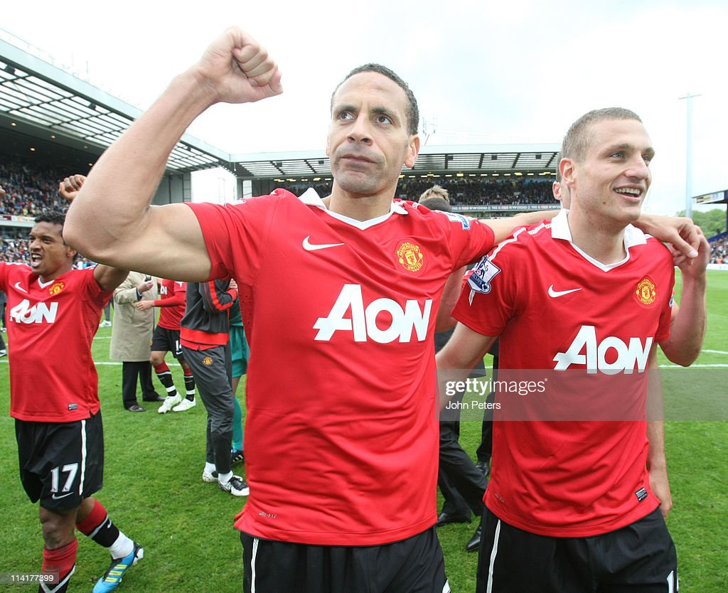 Rio Ferdinand and Nemanja Vidic of Manchester United celebrates winning the Premier League title after the Barclays Premier League match between Blackburn Rovers and Manchester United at Ewood Park on May 14, 2011 in Blackburn, England.