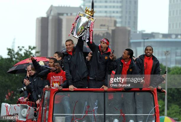 Rio Ferdinand and Nemanja Vidic of Manchester United lift the trophy during the Manchester United Premier League Winners Parade at Old Trafford on...