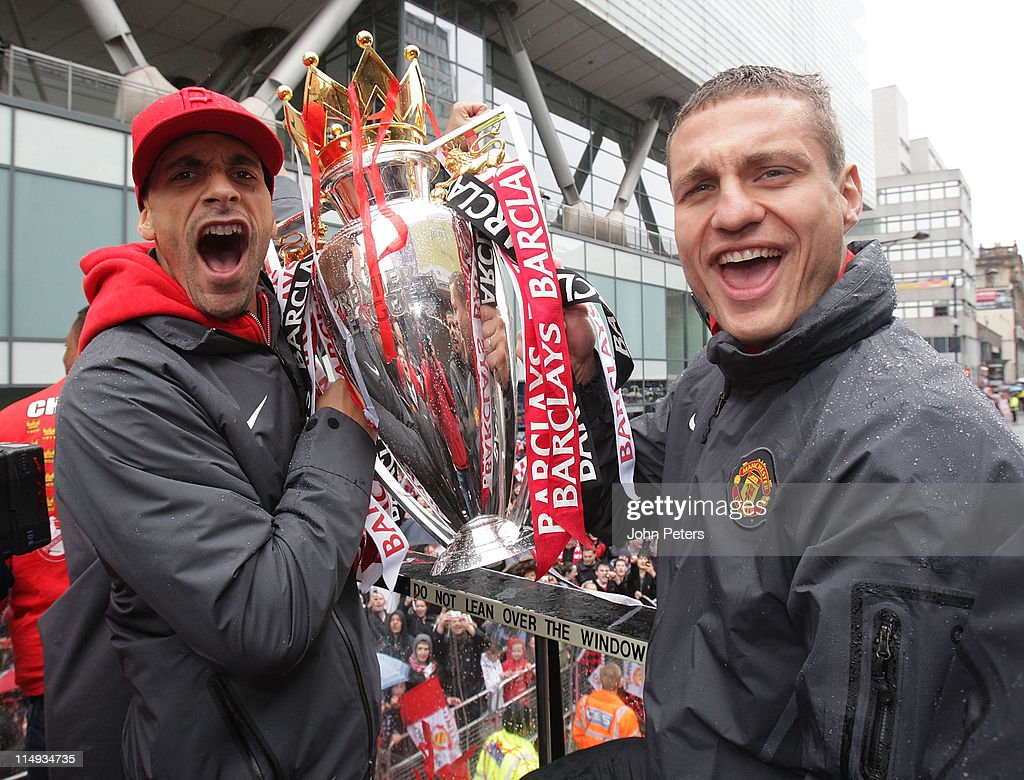 Rio Ferdinand (L) and Nemanja Vidic of Manchester United pose with the Barclays Premier League trophy during the Manchester United Premier League Winners Parade on May 30, 2011 in Manchester, England.