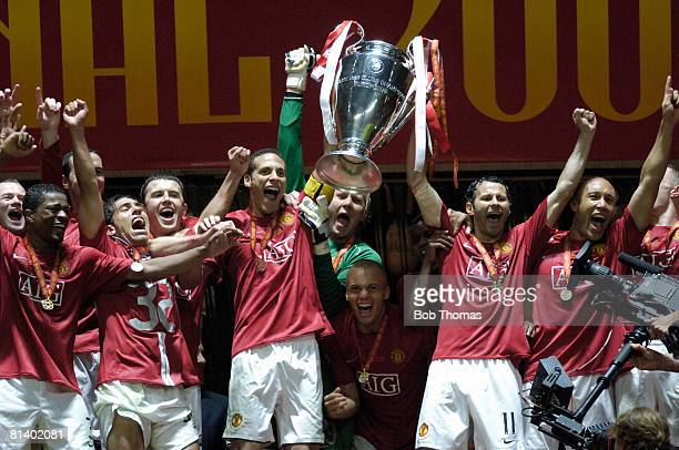 Rio Ferdinand and Ryan Giggs of Manchester United celebrate with the trophy after winning the UEFA Champions League Final between Manchester United...