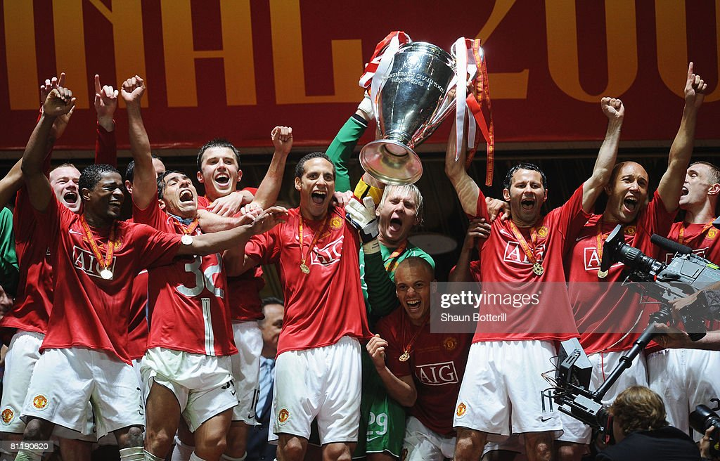 Rio Ferdinand and Ryan Giggs of Manchester United lift the trophy following their team's 6-5 victory in the penalty shootout during the UEFA Champions League Final match between Manchester United and Chelsea at the Luzhniki Stadium on May 21, 2008 in Moscow, Russia.