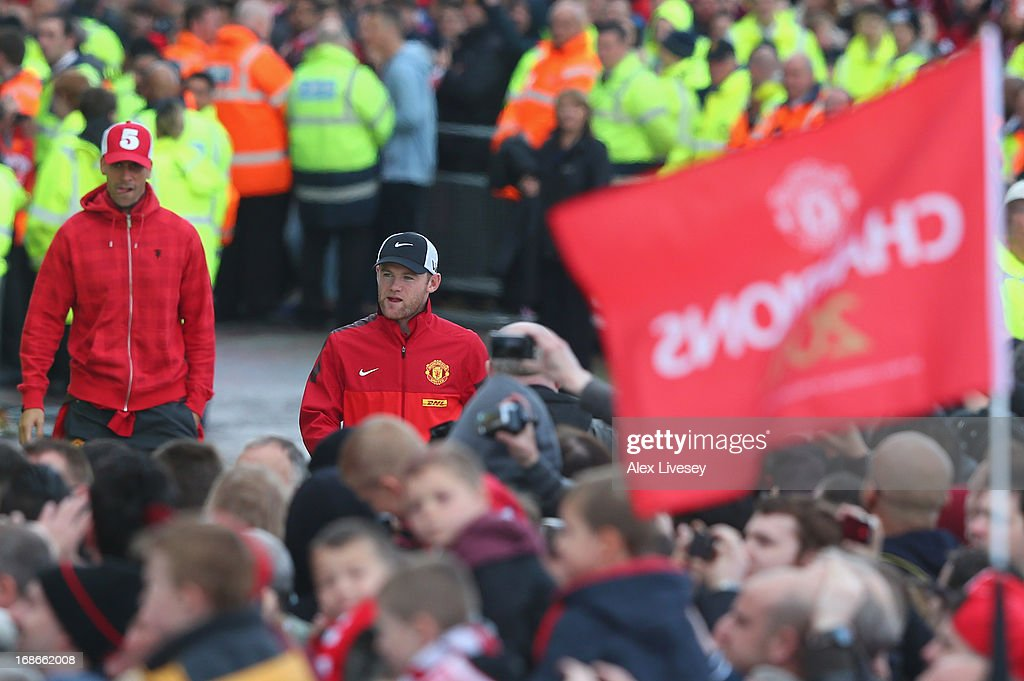 Rio Ferdinand (L) and Wayne Rooney arrive for the Manchester United Premier League winners parade at Old Trafford on May 13, 2013 in Manchester, England.