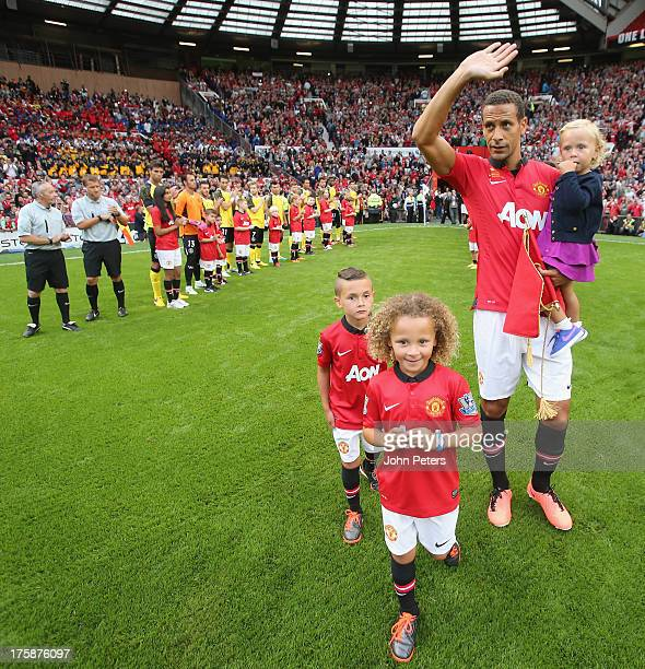 Rio Ferdinand greets fans before playing in the Rio Ferdinand Testimonial match between Manchester United and Sevilla FC at Old Trafford on August 9...