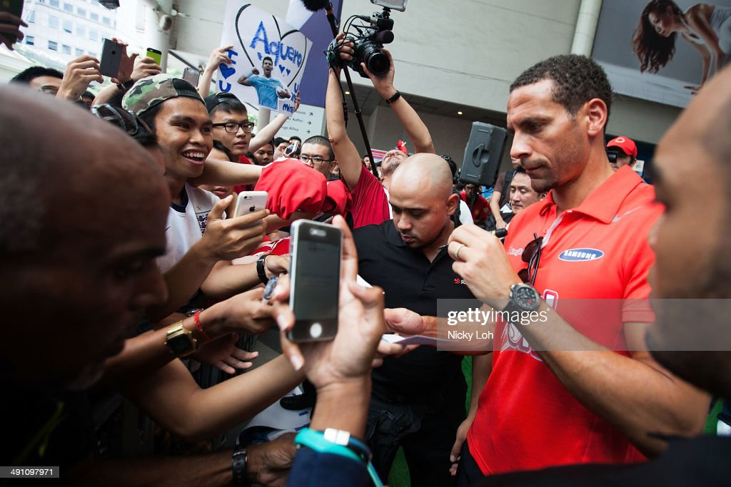 Rio Ferdinand greets supporters during a meet-the-fans session on May 16, 2014 in Singapore.