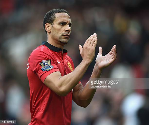 Rio Ferdinand of Manchester United applauds the fans after the Barclays Premier League match between Manchester United and Norwich City at Old...