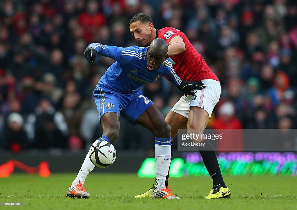 Rio Ferdinand of Manchester United battles for the ball with Demba Ba of Chelsea during the FA Cup sponsored by Budweiser Sixth Round match between Manchester United and Chelsea at Old Trafford on March 10, 2013 in Manchester, England.