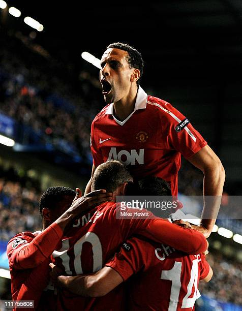 Rio Ferdinand of Manchester United celebrates after teammate Wayne Rooney of Manchester United scores the opening goal during the UEFA Champions...