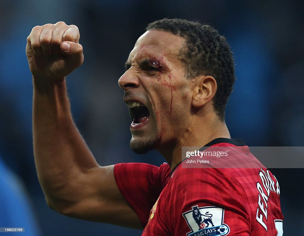<a gi-track='captionPersonalityLinkClicked' href=/galleries/search?phrase=Rio+Ferdinand&family=editorial&specificpeople=157538 ng-click='$event.stopPropagation()'>Rio Ferdinand</a> of Manchester United celebrates at the end of the game after being hit by an object thrown from the crowd during the Barclays Premier League match between Manchester City and Manchester United at Etihad Stadium on December 9, 2012 in Manchester, England.