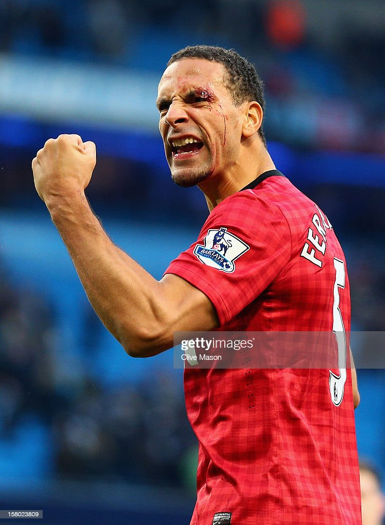<a gi-track='captionPersonalityLinkClicked' href=/galleries/search?phrase=Rio+Ferdinand&family=editorial&specificpeople=157538 ng-click='$event.stopPropagation()'>Rio Ferdinand</a> of Manchester United celebrates at the end of the Barclays Premier League match between Manchester City and Manchester United at the Etihad Stadium on December 9, 2012 in Manchester, England.