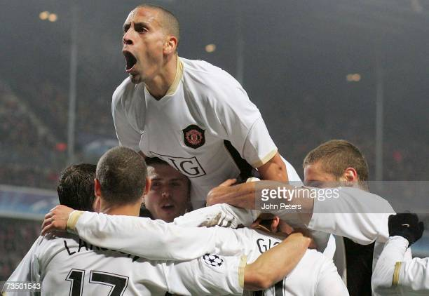 Rio Ferdinand of Manchester United celebrates Ryan Giggs scoring United's first goal during the UEFA Champions League First Knockout Round match...