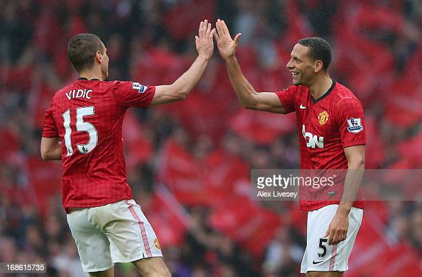 Rio Ferdinand of Manchester United celebrates scoring the winning goal with teammate Nemanja Vidic during the Barclays Premier League match between...