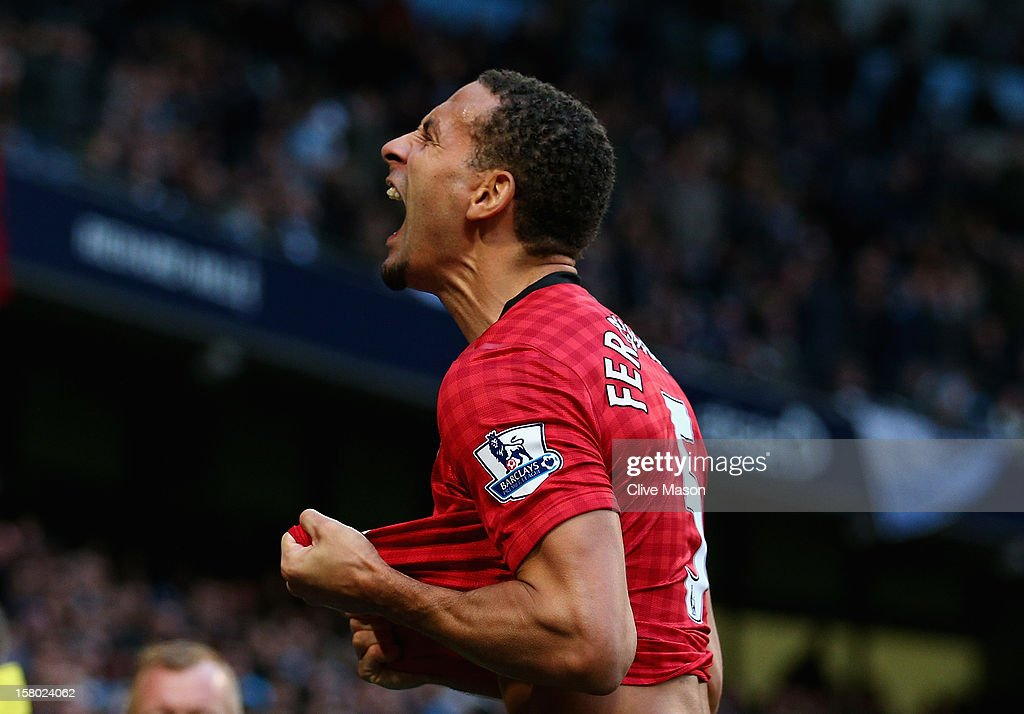 Rio Ferdinand of Manchester United celebrates the winning goal during the Barclays Premier League match between Manchester City and Manchester United at the Etihad Stadium on December 9, 2012 in Manchester, England.