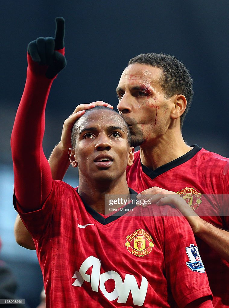 <a gi-track='captionPersonalityLinkClicked' href=/galleries/search?phrase=Rio+Ferdinand&family=editorial&specificpeople=157538 ng-click='$event.stopPropagation()'>Rio Ferdinand</a> of Manchester United celebrates with team-mate <a gi-track='captionPersonalityLinkClicked' href=/galleries/search?phrase=Ashley+Young&family=editorial&specificpeople=623155 ng-click='$event.stopPropagation()'>Ashley Young</a> (L) at the end of the Barclays Premier League match between Manchester City and Manchester United at the Etihad Stadium on December 9, 2012 in Manchester, England.