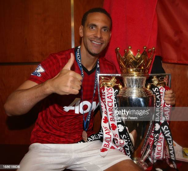 Rio Ferdinand of Manchester United celebrates with the Barclays Premier League trophy in the dressing room after the Barclays Premier League match...