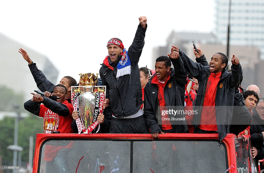 Rio Ferdinand (C) of Manchester United celebrates with the trophy during the Manchester United Premier League Winners Parade at Old Trafford on May 30, 2011 in Manchester, United Kingdom.