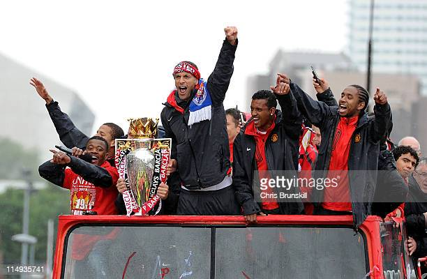 Rio Ferdinand of Manchester United celebrates with the trophy during the Manchester United Premier League Winners Parade at Old Trafford on May 30...
