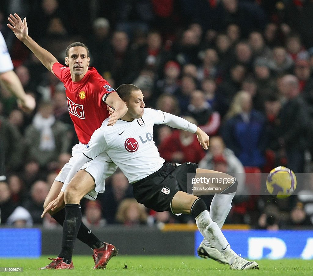 Rio Ferdinand of Manchester United clashes with Bobby Zamora of Fulham during the Barclays Premier League match between Manchester United and Fulham...