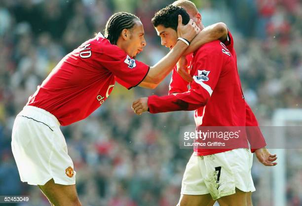 Rio Ferdinand of Manchester United congratulates goal scorer Cristiano Ronaldo on scoring the opening goal during the FA Barclays Premiership match...