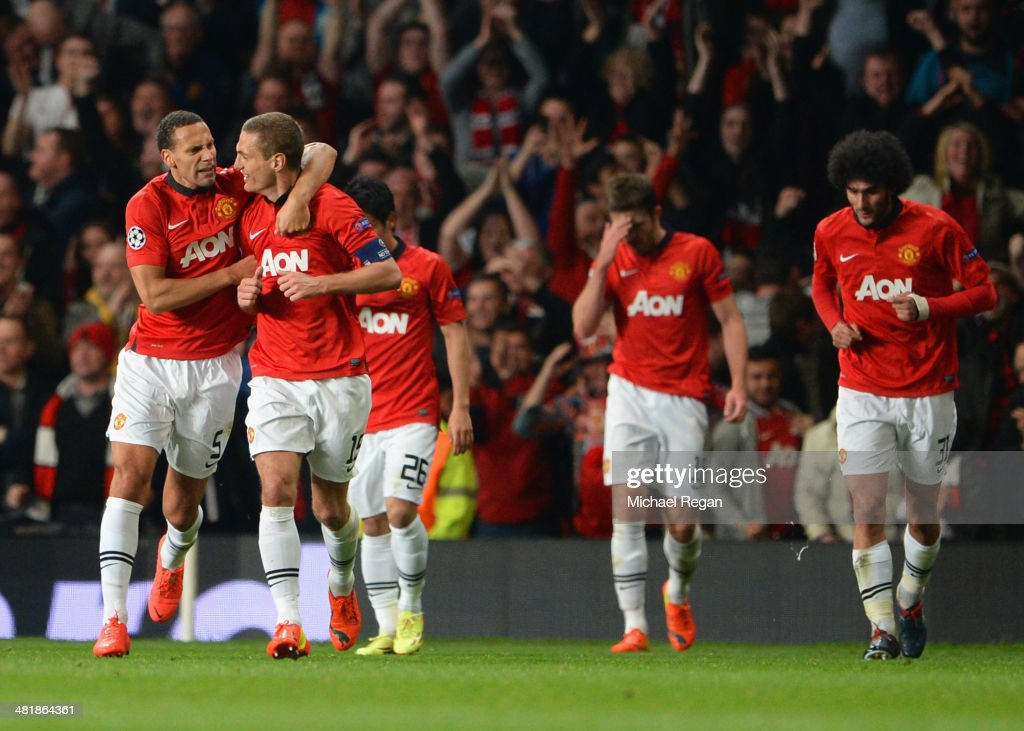 <a gi-track='captionPersonalityLinkClicked' href=/galleries/search?phrase=Rio+Ferdinand&family=editorial&specificpeople=157538 ng-click='$event.stopPropagation()'>Rio Ferdinand</a> of Manchester United congratulates <a gi-track='captionPersonalityLinkClicked' href=/galleries/search?phrase=Nemanja+Vidic&family=editorial&specificpeople=497253 ng-click='$event.stopPropagation()'>Nemanja Vidic</a> of Manchester United on scoring the opening goal during the UEFA Champions League Quarter Final first leg match between Manchester United and FC Bayern Muenchen at Old Trafford on April 1, 2014 in Manchester, England.