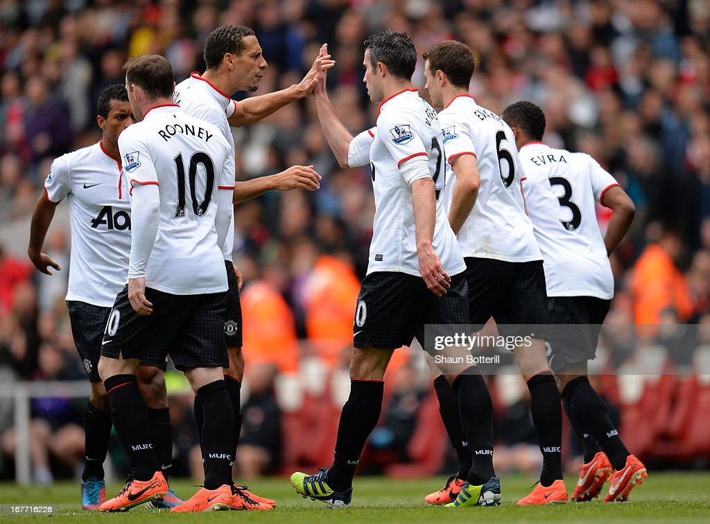 <a gi-track='captionPersonalityLinkClicked' href=/galleries/search?phrase=Rio+Ferdinand&family=editorial&specificpeople=157538 ng-click='$event.stopPropagation()'>Rio Ferdinand</a> of Manchester United congratulates Robin van Persie of Manchester United after he scored from the penalty spot to make it 1-1 during the Barclays Premier League match between Arsenal and Manchester United at Emirates Stadium on April 28, 2013 in London, England.