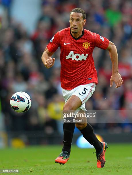 Rio Ferdinand of Manchester United controls the ball during the Barclays Premier League match between Manchester United and Tottenham Hotspur at Old...